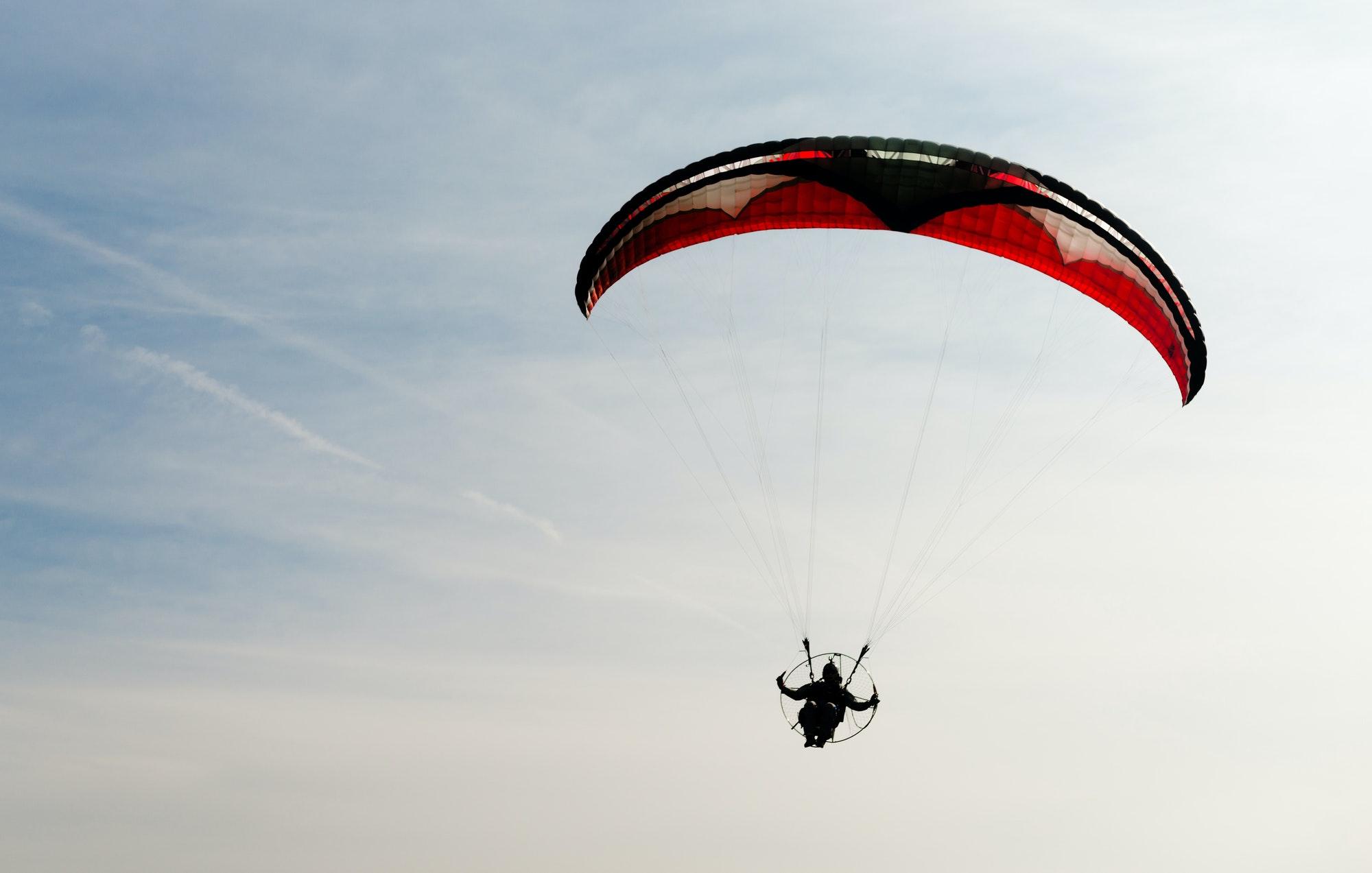 One Man Rides Flies Ultralight Flying Through Blue Sky